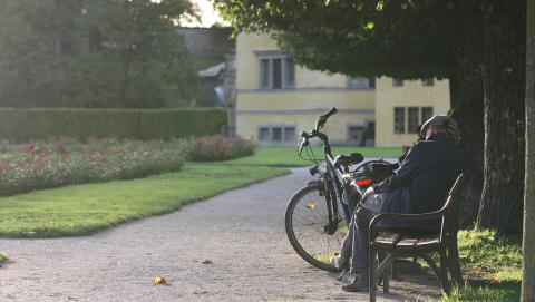 image of elderly man on a park bench