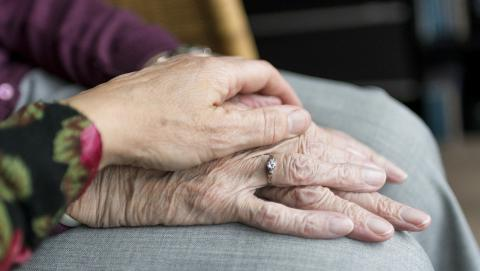 image of someone's hand over another person's hand